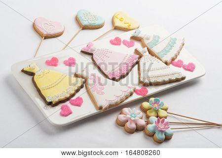 Cookies With Glaze In The Form Of Hearts, Dresses And Flowers.