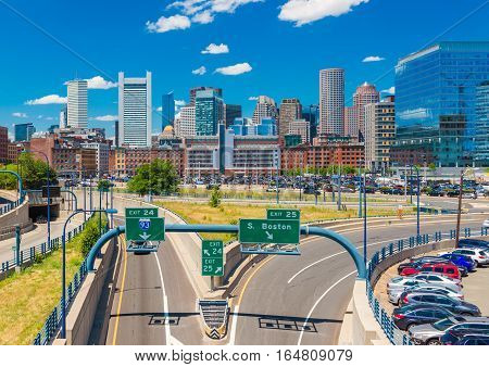 Boston - June 2016, MA, USA: Boston skyline in sunny summer day, view of skyscrapers, office buildings in downtown and highway with no traffic