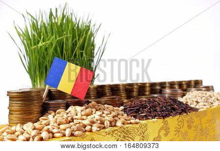 Romania Flag Waving With Stack Of Money Coins And Piles Of Wheat And Rice Seeds