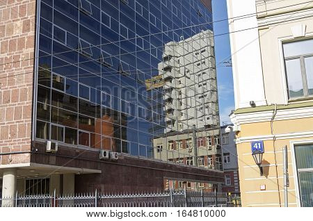 Reflection of buildings in the glass wall. Myasnitskaya Street 39/1 Moscow Russia.