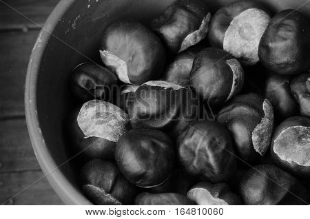 bowl of chestnuts autumn fall closeup black white
