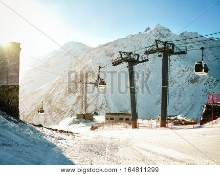 Funicular cable way at mountain background with sunlight in Caucasus (Elbrus) Russia