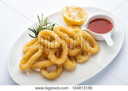 squid rings in batter. Lemon, red sauce