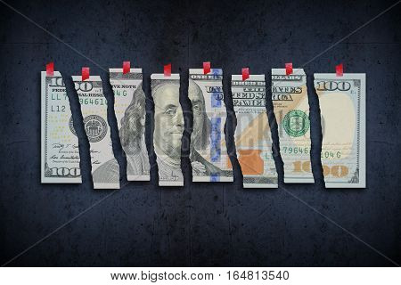 US Dollar bill cut in pieces suggesting weak economy