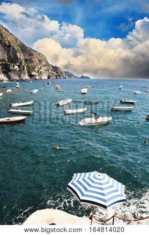 Small vessels sailing along the coast line in Praiano, Amalfi Coast - Italy