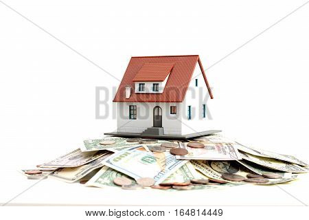 House ownership concept - a model house on a pile of coins