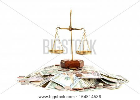 Empty brass balance on pile of money