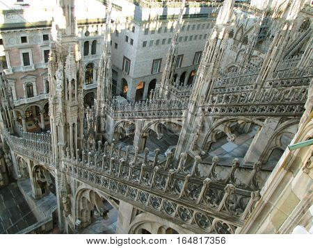 Gorgeous decoration of Duomo di Milano (Cathedral of Milan) as seen from rooftop terrace, Italy