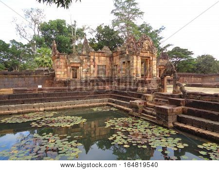 Reflection of Prasat Hin Muang Tam Temple on the Ancient Pond, Buriram Province of Thailand