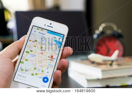 Bangkok, Thailand - December 9, 2016: A man using google map to travel in Hong Kong.