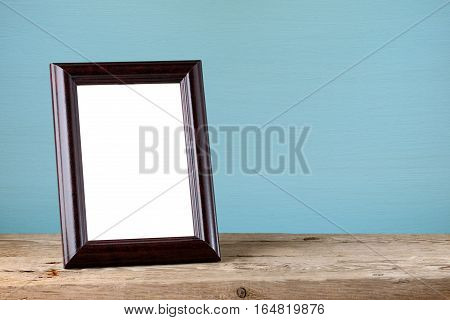 Wooden photo frame on old wooden table