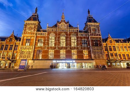 Amsterdam Central Station main train station is the real heart of the city and the biggest public transport transfer spot in Amsterdam Netherlands.