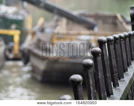 Fence dredging the river. Working on the dredger clears the bottom of the canal from the scrap metal and sediment