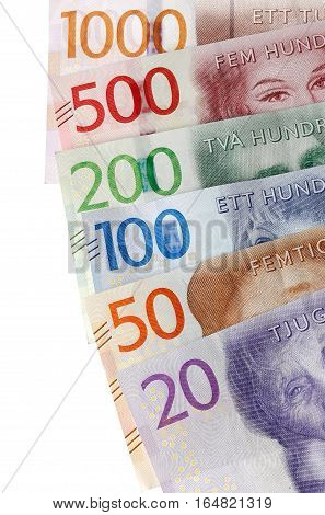 Parts of Swedish banknotes faned in the dominations of 20 50 100 200 500 and 1000 krona.