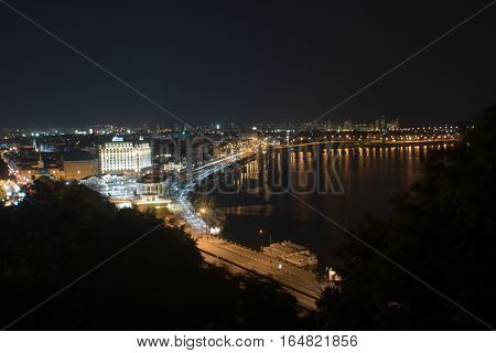 Bustle of the city, the road and the car on the bridge at night by the light