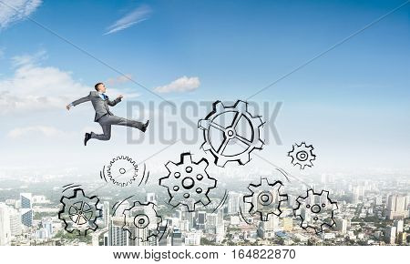 Young businessman against city background running in a hurry