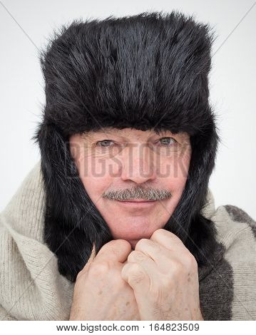 Elderly Man Bundled Up In Fur Hat And Warm Scarf. Very Cold Winter And Unfavorable Weather Forecast.