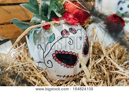 pumpkin for Halloween, a festive decoration for Halloween, dead head in Mexican-style