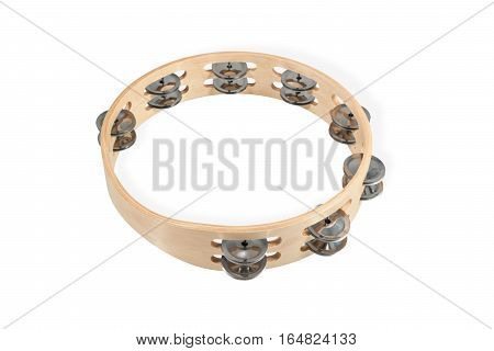 Wooden timbrel with metal plates lying horizontally isolated on white background