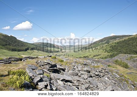 Beautiful landscape Snowdonia wales Slate quarry overlooking blue sky and rolling hills