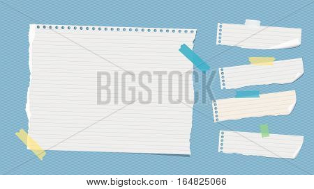 Ripped white ruled note, notebook, copybook paper sheets stuck with colorful sticky tape on blue squared pattern.