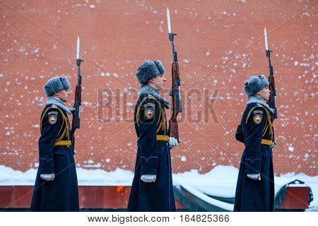 MOSCOW RUSSIA - JANUARY 05 2017: Hourly change of the Presidential guard of Russia at the Tomb of Unknown soldier and Eternal flame in Alexander garden near Kremlin wall. Winter view.