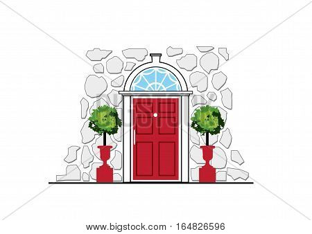 Red door on stone wall house with topiary