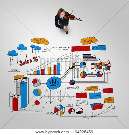 Top view of woman and business strategy sketches on floor