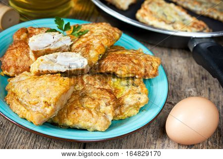Fish fillet fried in egg batter rustic food
