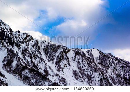 mountain gorge, snow slopes, winter landscape, nature of the North Caucasus, Ossetia