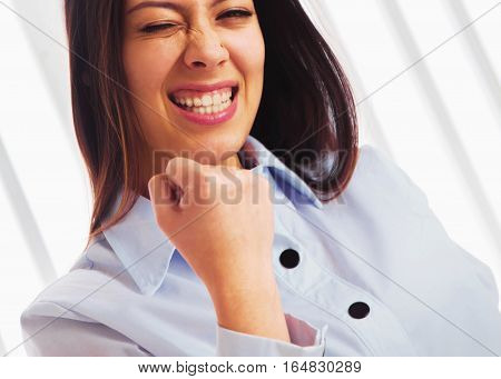 Portrait of a very happy business woman celebrating good news (victory power money freedom)