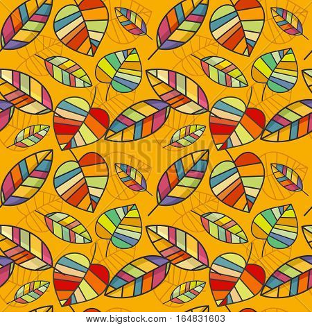 Vector seamless pattern with colorful leaves. Drawing on a bright yellow background. The leaves are medium sized. Figure bright multicolored mosaic type. Drawing can be used for wallpaper poizvodstva, the substrate or background.