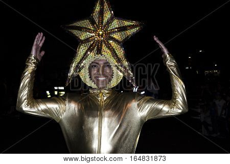SAN JOSE, COSTA RICA - December 18:  Man with a star costume during the Festival of Light Parade  whichl is part of Christmas and holiday season Festivities in Costa Rica. December 18, 2016 in San Jose.
