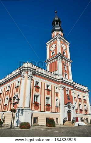 Baroque Town Hall with clock tower on the market in Leszno