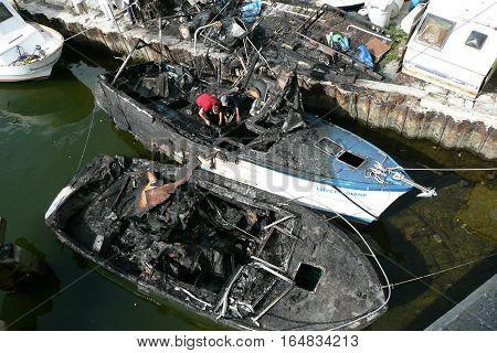 Miami, Florida - 2008-05-12:  Miami River Area - Fire Damaged Fishing Boats
