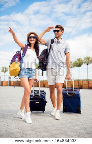 Young Happy Family Having Honeymoon And Finding Way To Hotel