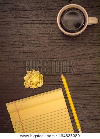 Dark surface paper wad pencil coffee black