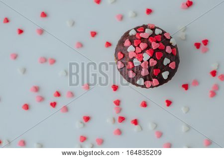 Cupcakes with small hearts on white backdrop. Romantic love concept. Valentine's day card. Valentines background.