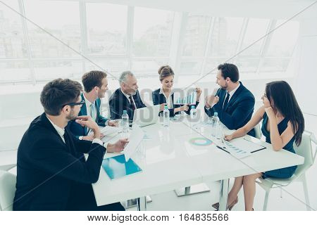 Workers At Business Meeting Looking At Presentation Of Financial  Growth
