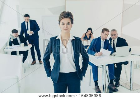 Young Executive Manager On The Background Of Busy Working Staff