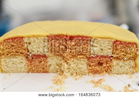 Tasty homemade cake with bautiful yellow icing