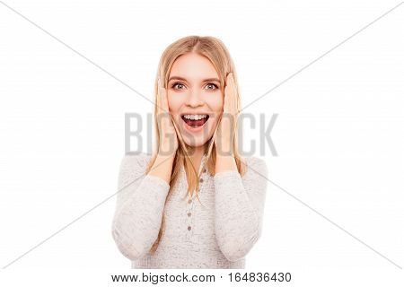 Portrait Of Happy Shocked Young Woman With Opened Mouth Touching Face