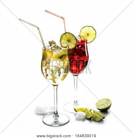 Two cocktail glasses yellow and red mixed drinks from juice lime and ice with or without alcohol isolated on a white background selected focus narrow depth of field