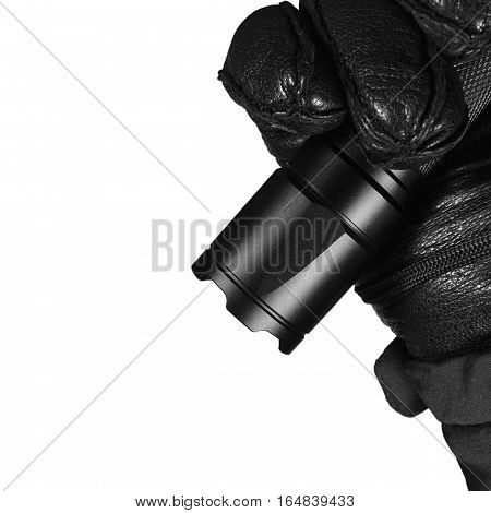 Gloved Hand Holding Tactical Flashlight Bright Light Brightly Lit Strike Bezel Black Grain Leather Glove Cop Jacket, Isolated Vertical Closeup, Police Security Guard Policeman Patrol, Forensic Officer