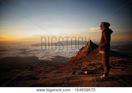 Mount Kinabalu is the highest mountain in Southeast Asia and is one of the most popular 'bucket list' destinations in the world. Conquer the mountain give yourself a hard-earned pat on the back! Mount Kinabalu, Sabah, Malaysia.