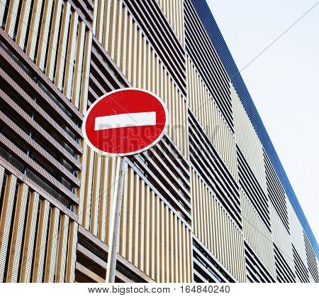 stop sign near new parking building, empty street nobody concept background