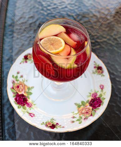 Homemade delicious sangria with orange and raspberry.