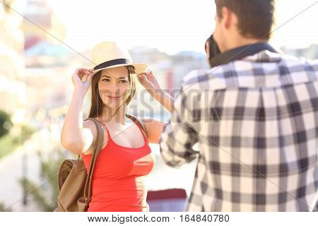 Couple of tourists taking photos in the street on holidays in a sunny day
