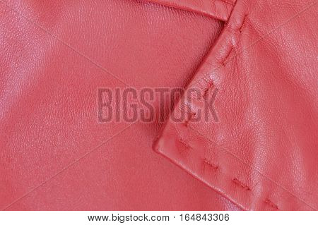 A woman's red leather coat showing a lapel.