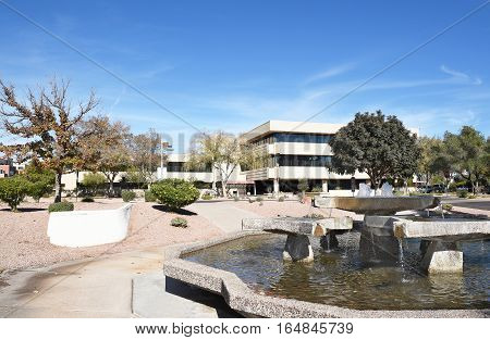 SCOTTSDALE ARIZONA - DECEMBER 9 2016: One Civic Center and fountain. The building houses city offices including Parks and Recreation and Planning and Development.